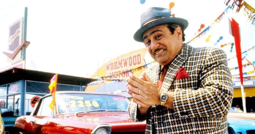"still image from the movie, ""Matilda"", depicting Danny DeVito as used car salesman, ""Harry Wormwood""."