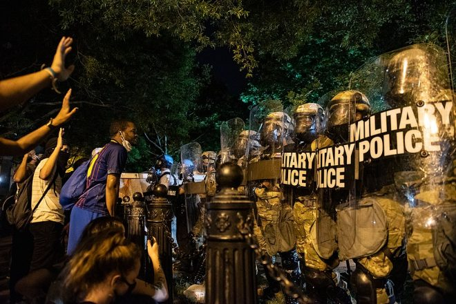 Military police lined up across from protesters, blocking entrance to Lafayette Park, opposite to the White House.