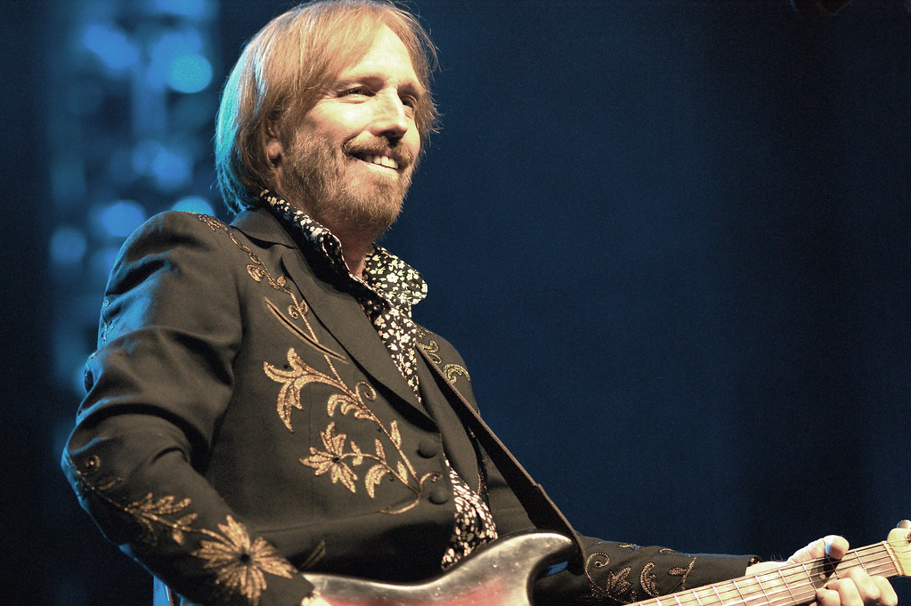 photo of the late classic rock superstar Tom Petty performing in concert