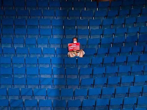 A lone Trump supporter sitting in the stands in Tulsa