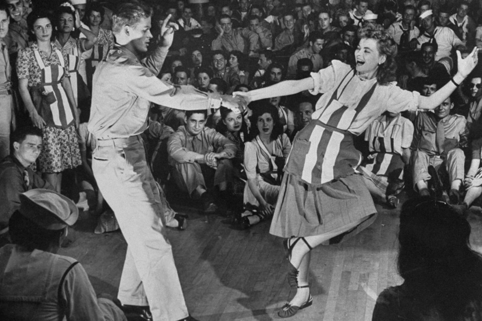 Black and White photo of serviceman dancing with USO entertainer