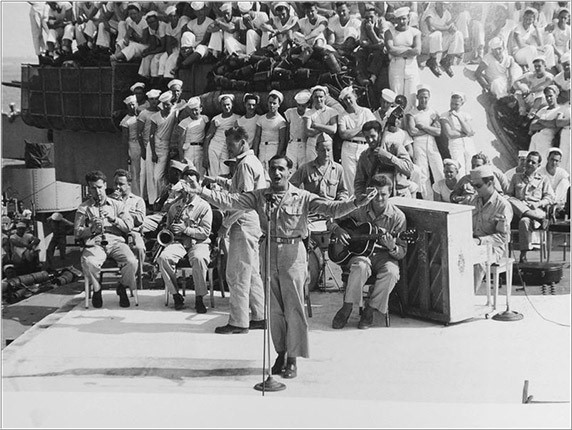 Black and White photo of a USO performance for the troops in WWII