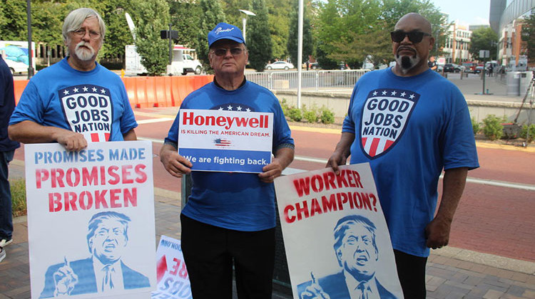 """Workers from """"Good Jobs Nation"""" protest Donald Trump's domestic policies that have made their job opportunities and situation worse."""