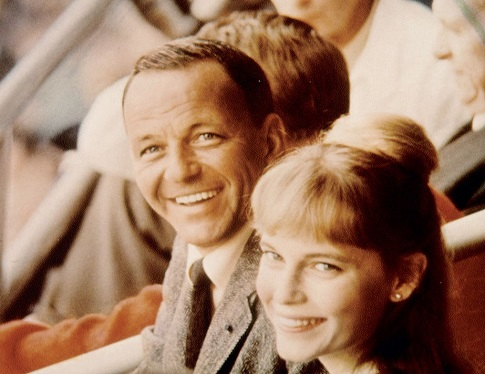 photo of Frank Sinatra and then wife, actress Mia Farrow attending a sporting event.