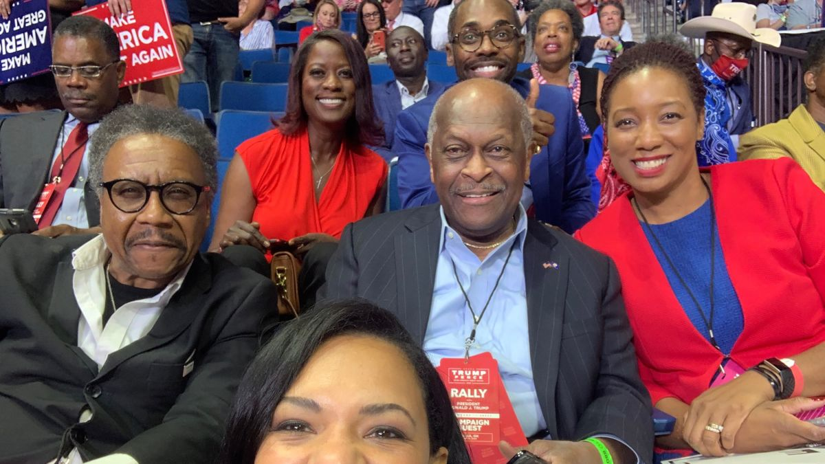 photo of Herman Cain, former CEO of Godfather's Pizza and Republican candidate for the 2012 GOP presidential nomination, attending the Trump rally in Tulsa, Oklahoma and died from COVID-19 a month later.