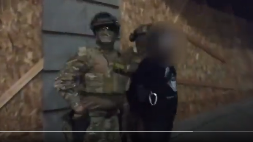 screenshot from blurry video footage of federal agents arresting protesters in Portland on no specific charges