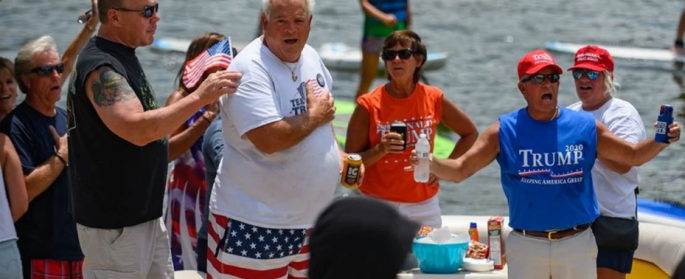 "Trump supporters and COVID-19 ""Truthers"" crowded together on a boat with no social distancing or protective face covering during a 4th of July boat parade"