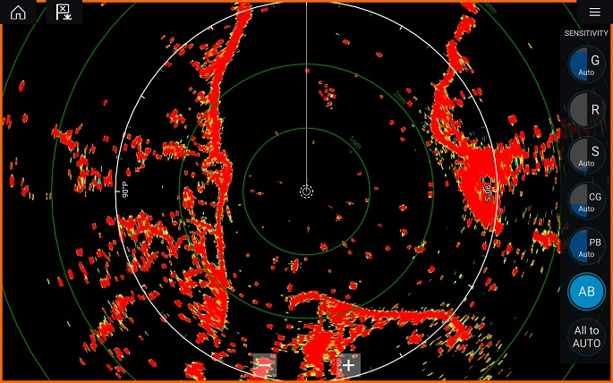 photo of modern on ship radar screen with black background and orange imaging