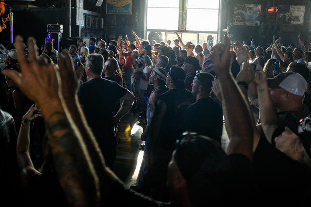People cheer during a concert at the Full Throttle Saloon during the 80th Annual Sturgis Motorcycle Rally on August 7, 2020 in Sturgis, South Dakota. MICHAEL CIAGLO / GETTY IMAGES