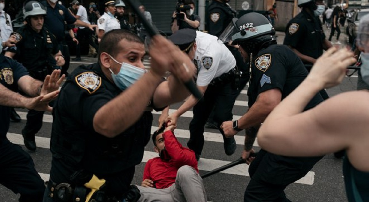 NYPD officers beating protesters at a demonstration in Manhattan against excessive force and the killing of black men such as George Floyd.