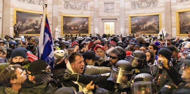 Rioters and police clash inside the Capital Building