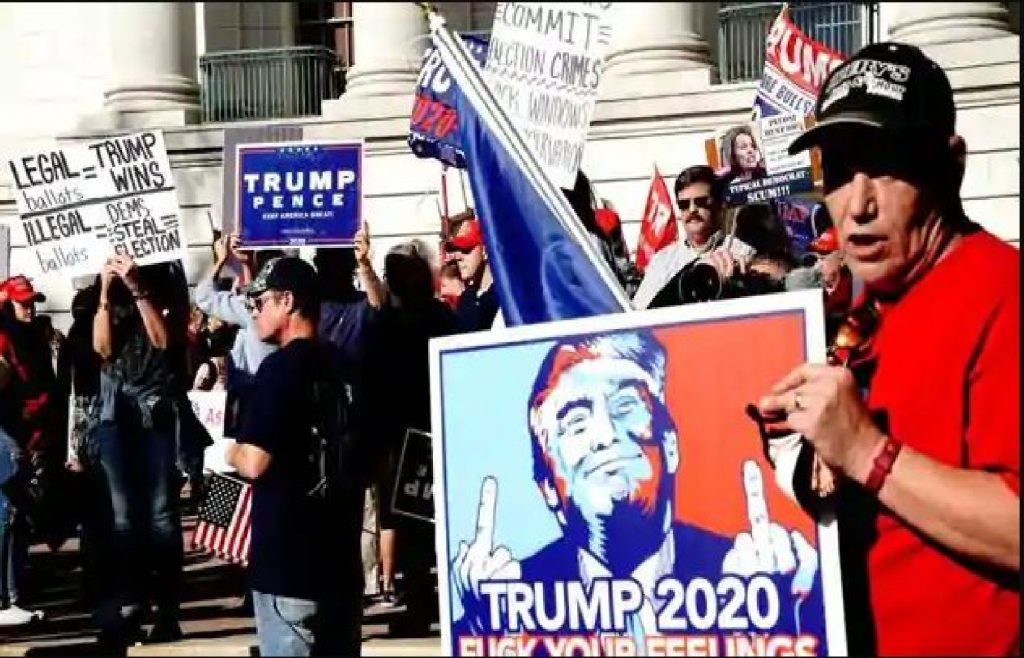 """Pro Trump protesters with """"Stop the steal"""" and other signs"""