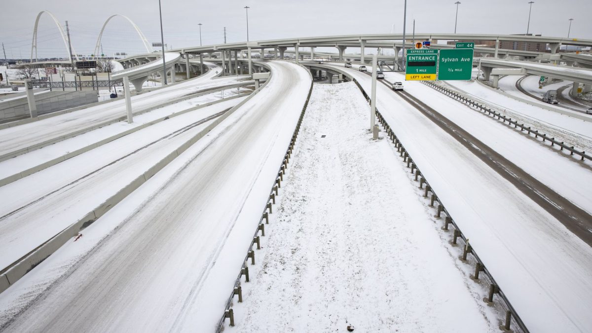 staff photo from Dallas Morning News showing major freeway interchange in Texas blanketed with snow