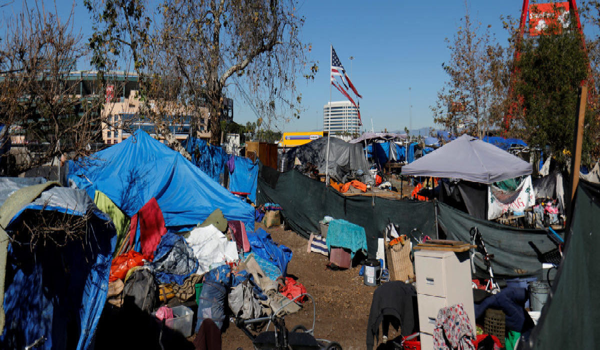 homeless camp of tents and gathered belongings in California