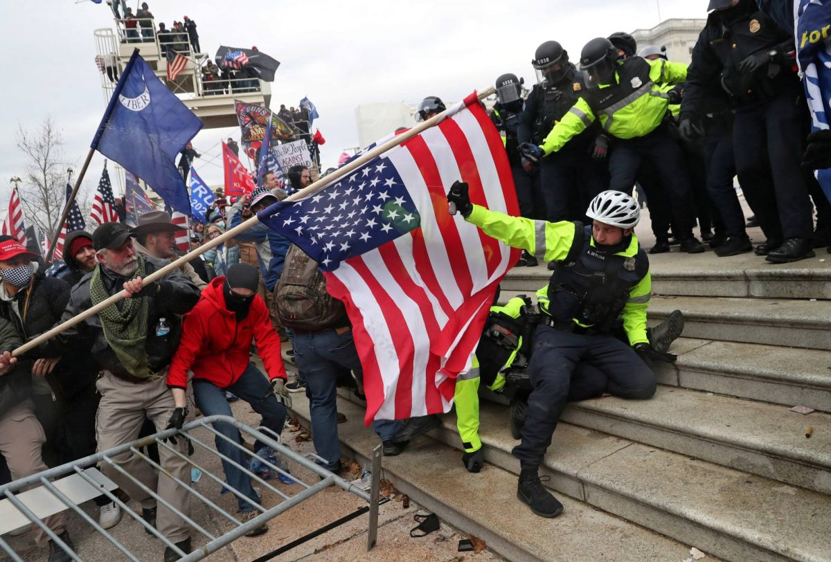 a press pool photo of a group of Trump anarchists and Qanon followers breaching the steps and entrance of the U.S. Capitol on January 6, 2021