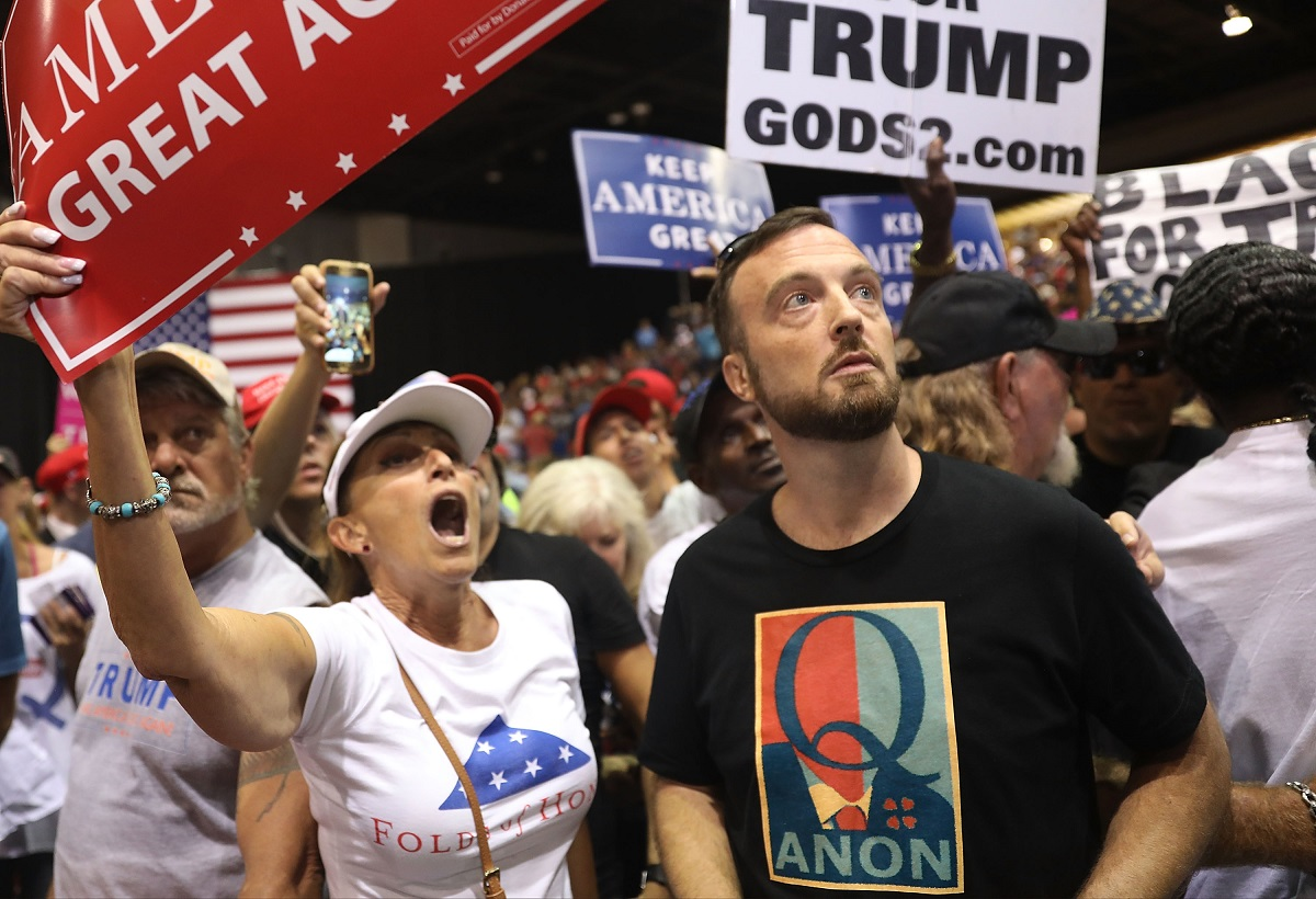Followers of the Qanon movement in attendance at a Trump rally