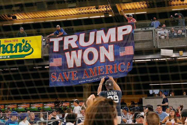 Trumpanistas unfurl a banner in support of twice impeached, deplatformed U.S. President Donald Trump during the fourth inning of Game Two of a doubleheader between the Toronto Blue Jays and the New York Yankees at Yankee Stadium on May 27, 2021 in the Bronx borough of New York City.