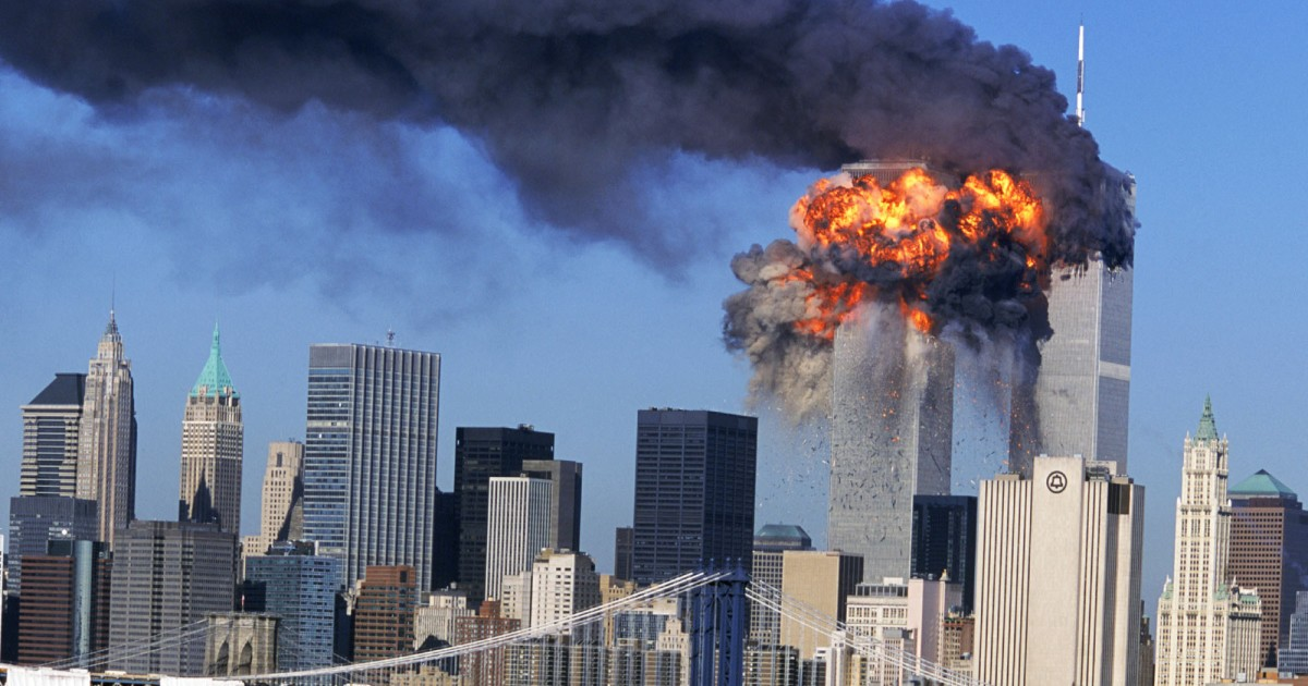 photo of New York City (Manhattan) Skyline on 9-11-01 showing the World Trade Center exploding from direct hits from terrorist controlled airliners.
